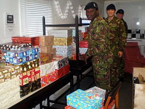 Soldiers collecting shoeboxes