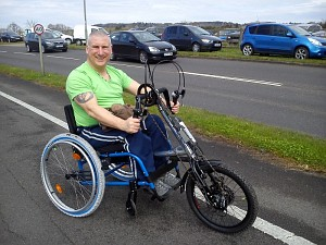 Trevor Bailey shows off his new hand cycle